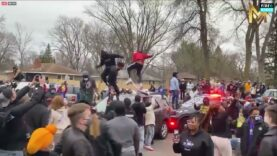 BLM-crowd-starting-to-jump-on-police-cars-after-officer-involved.jpg