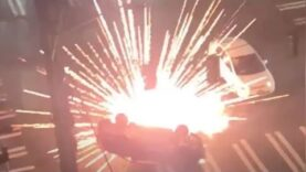Large-crowd-shoot-fireworks-at-a-car-after-they-first.jpg