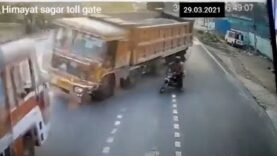 Motorcyclist causes horrible accident with two trucks near Hyderaba, India.