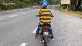 Motorcycle-rider-waits-for-road-to-clear-only-to-lose.jpg