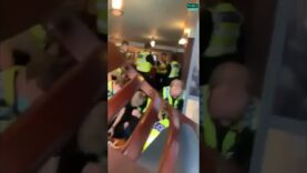 WATCH: Bank holiday brawl between police and punters at Wetherspoons'