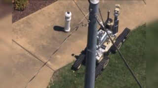 Explosive Ordnance Disposal (EOD) Robot clears suspicious package at CIA's