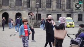 Muslim woman encourages young boy to spit on protesters carrying