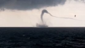 Odd waterspout recorded on video on the horizon of the