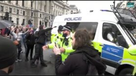 Police pushing protesters back from the road at anti-lockdown protest