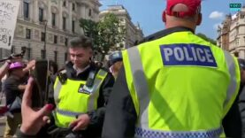London Police take-off their riot gear in support of the