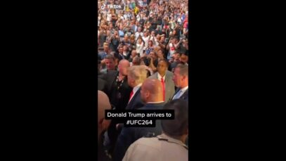 Thousands chant 'USA' as former President Donald Trump enters the