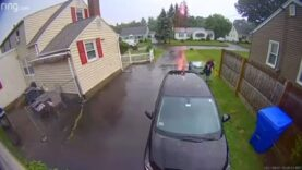 WATCH: Man carrying trash barrel almost struck by lightning in